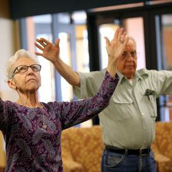 Alzheimer patient Anita Musto and her boyfriend Denver Carder participate in Tai Chi at Sagewood at Daybreak Assisted Living in South Jordan on Tuesday, Aug. 9, 2016.