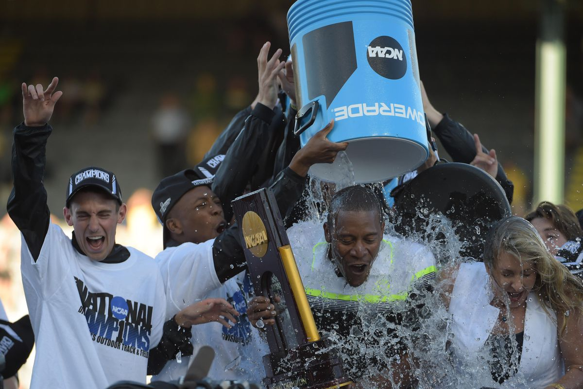 Head Oregon track and field coach Robert Johnson (and an unsuspecting reporter) got a Powerade shower during his post-NCAA championship interview