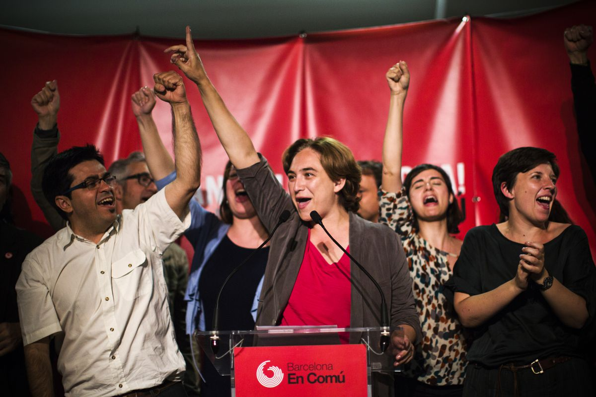 Ada Colau (center), leader of leftist coalition Barcelona Together, celebrates her party's victory in Barcelona, on May 24, 2015.