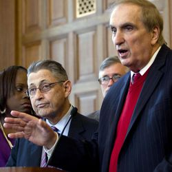 FILE- In this April 18, 2012, file photo, Assemblyman Vito Lopez, D-Brooklyn, speaks during an affordable housing news conference as Assembly Speaker Sheldon Silver, D-Manhattan, left, listens, at the Capitol in Albany, N.Y. Accusations of sexual harassment that emerged over the summer have unraveled in public before a state ethics committee, revealing more sexual misconduct accusations against Lopez and a secret six-figure payoff to the accusers with taxpayer money that was approved by Silver.
