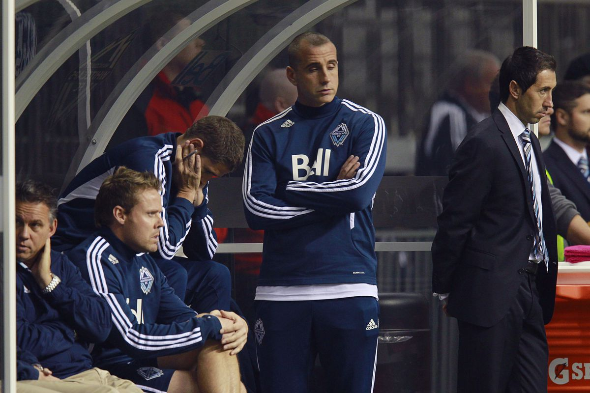 Whitecaps coaches look on as their team fails to do the easiest thing in MLS--beat Portland at home.