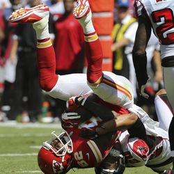 Kansas City Chiefs wide receiver Dwayne Bowe (82) is tackled by Atlanta Falcons cornerback Brent Grimes (20) during the first half of an NFL football game at Arrowhead Stadium in Kansas City, Mo., Sunday, Sept. 9, 2012.