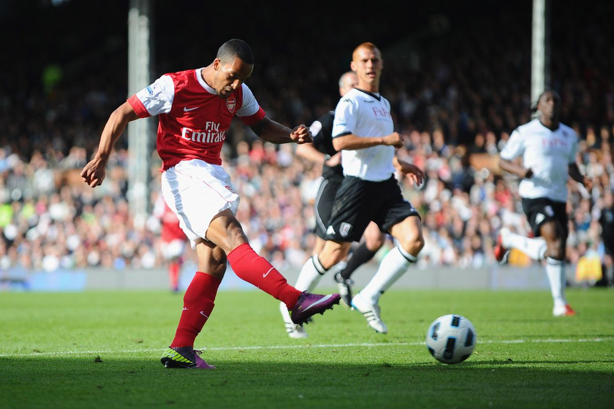 LONDON, ENGLAND - MAY 22:  Theo Walcott of Arsenal scores during the Barclays Premier League match between Fulham and Arsenal at Craven Cottage on May 22, 2011 in London, England.  (Photo by Clive Mason/Getty Images)