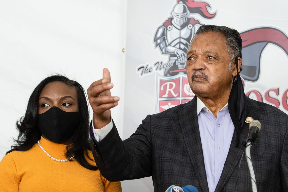 """Civil rights leader the Rev. Jesse Jackson and Dr. Kizzmekia """"Kizzy"""" Corbett, the Black woman who co-led the National Institutes of Health team that discovered Moderna's coronavirus vaccine, on Friday urged the Black community to get vaccinated. The renowned immunologist was in Chicago to accompany Jackson to his vaccination at Roseland Community Hospital, as part of efforts to battle distrust of the vaccine in the Black community."""