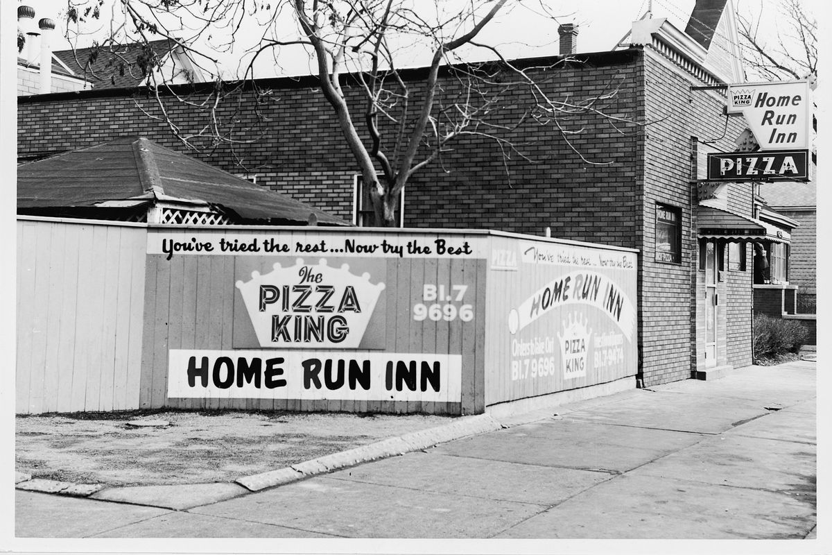 "A sign on the fence of Home Run Inn tavern reads ""You've tried the rest ... Now try the best."" It opened in 1947."
