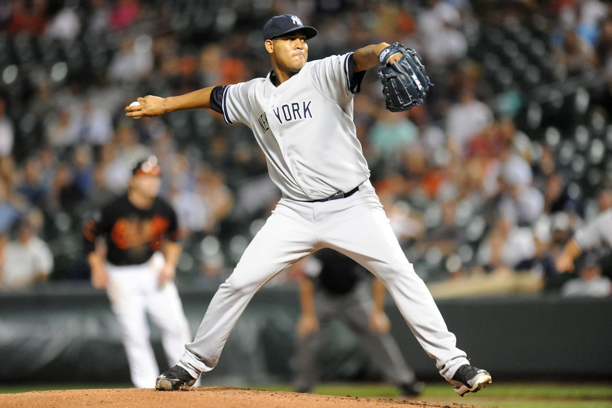 BALTIMORE, MD - AUGUST 28:  Ivan Nova #47 of the New York Yankees pitches during a baseball game against the Baltimore Orioles at Oriole Park at Camden Yards on August 28, 2011 in Baltimore, Maryland.  (Photo by Mitchell Layton/Getty Images)