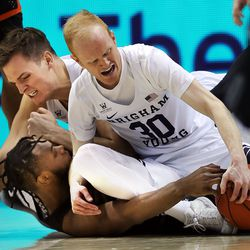 BYU Cougars guard TJ Haws (30) comes away with a loose ball as teammate Luke Worthington and Pacific Tigers forward Jahlil Tripp, bottom, also fight for possession during a West Coast Conference game at the Marriott Center in Provo on Saturday, Feb. 9, 2019.