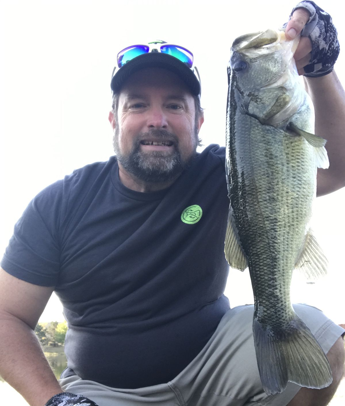 """Ken """"Husker"""" O'Malley with a nice local largemouth bass. Provided photo"""