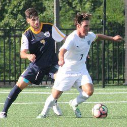 Zach Zandi on the ball with Eden Ben Hemo defending