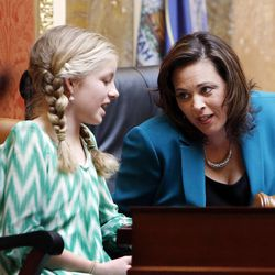 House Speaker Becky Lockhart, R-Provo, talks with Megan Pyrah in the House of Representatives at the Utah Capitol in Salt Lake City on Monday, Jan. 27, 2014. Lockhart, the first woman to serve as Utah House speaker, died at her home Saturday, Jan. 17, 2015, from an unrecoverable and extremely rare neurodegenerative brain disease. Lockhart she was 46.