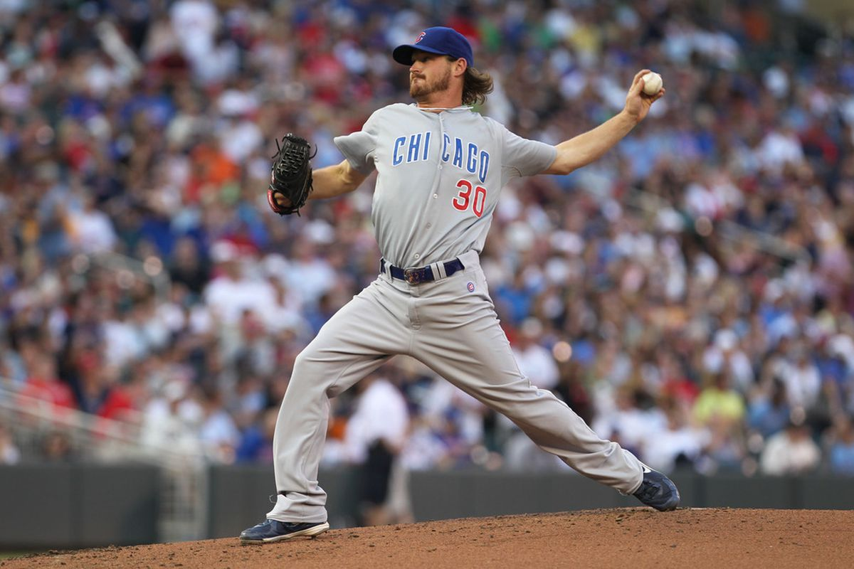 June 8, 2012; Minneapolis, MN, USA; Chicago Cubs pitcher Travis Wood (30) delivers a pitch during the first inning against the Minnesota Twins at Target Field. Mandatory Credit: Brace Hemmelgarn-US PRESSWIRE
