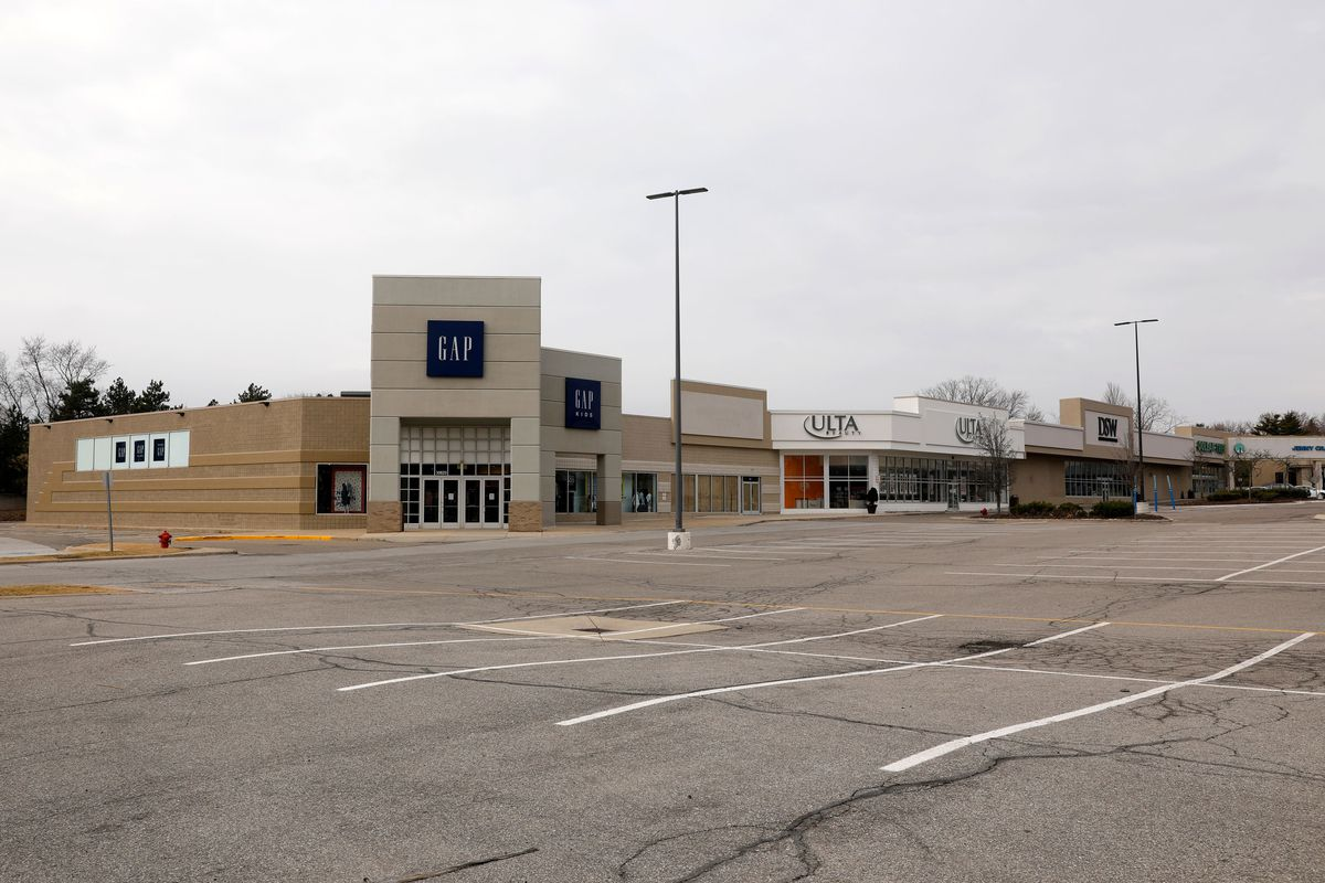 A shopping center with closed retail stores due to the COVID-19 outbreak in Farmington Hills, Michigan, on March 26, 2020.