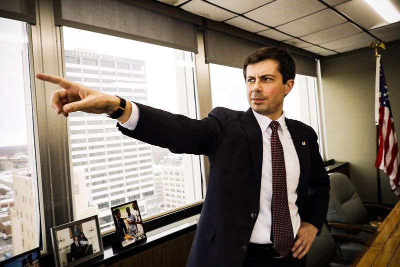 Mayor Pete Buttigieg points as he talks to an AP reporter at his office in South Bend, Ind., on January 10, 2019.