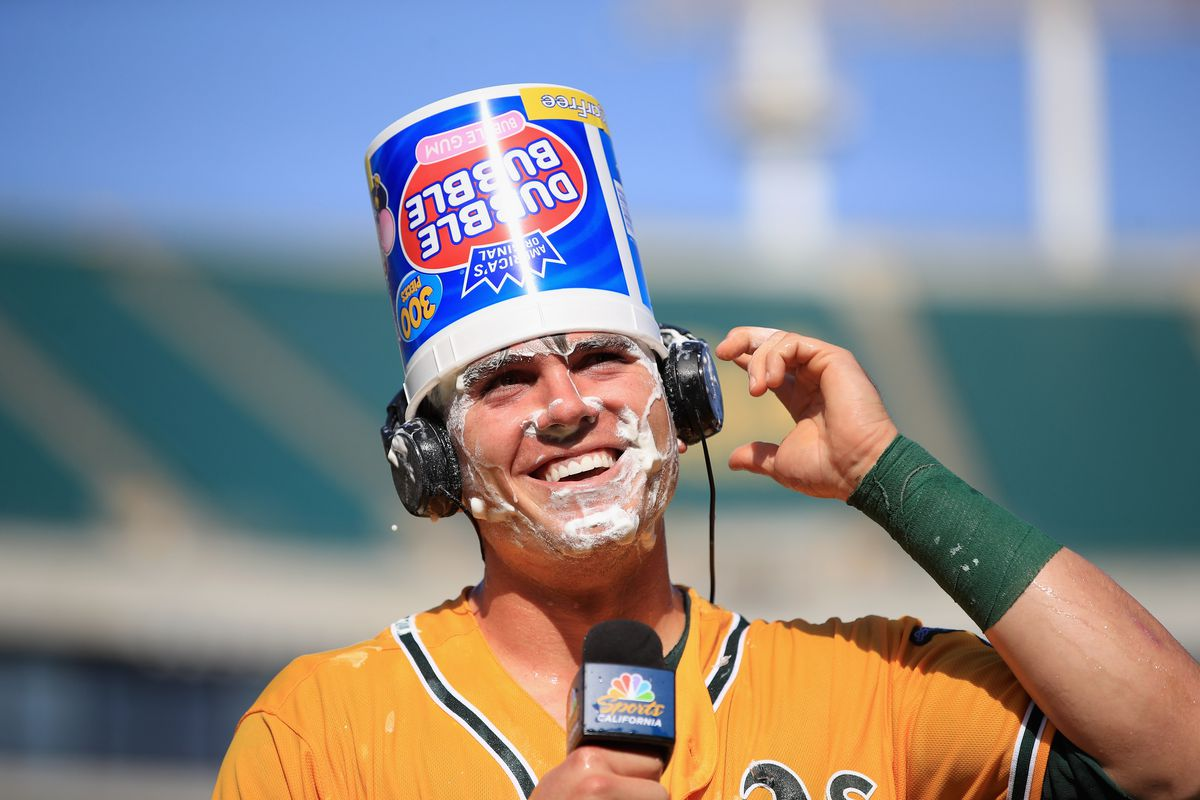 OAKLAND, CA - MAY 07:  Ryon Healy #25 of the Oakland Athletics is interviewed after he hit a walk-off home run in the ninth inning against the Detroit Tigers at Oakland Alameda Coliseum on May 7, 2017 in Oakland, California.  (Photo by Ezra Shaw/Getty Images)