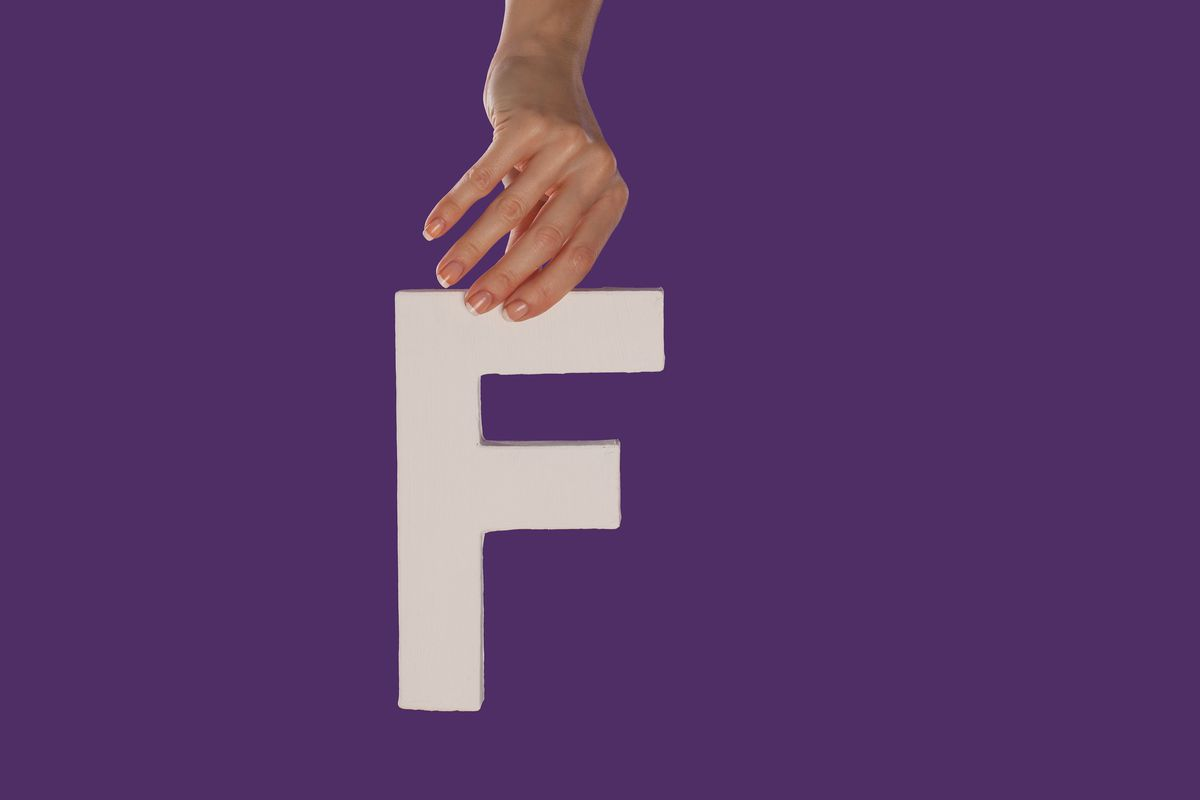 This stock photo model thought the letter F she was holding would to illustrate fun, frankfurters, or foosball. She had no idea.