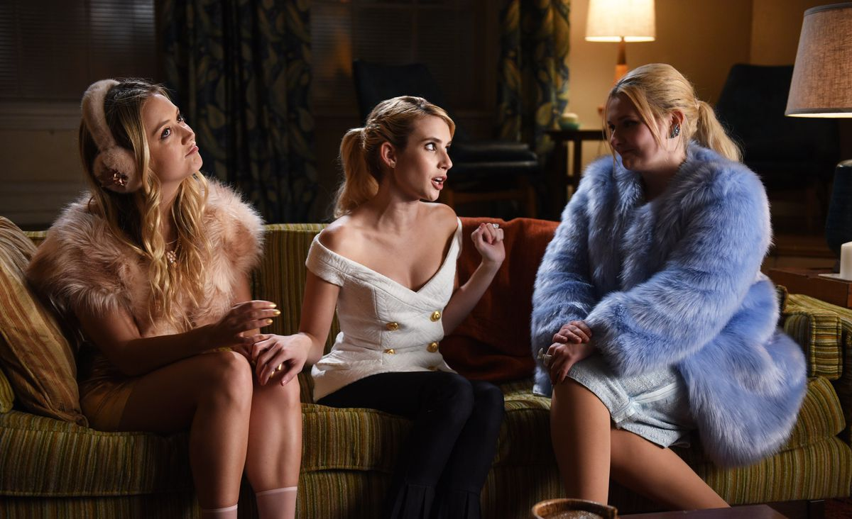 Billie Lourd as Chanel No. 3, Emma Roberts as Chanel Oberlin, and Abigail Breslin as Chanel No. 5 on Scream Queens.