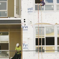 Construction continues on the 4th West Apartments in Salt Lake City on Thursday, Sept. 29, 2016.