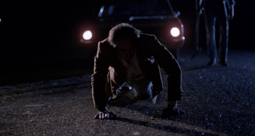 blood simple: man crawls in front of car