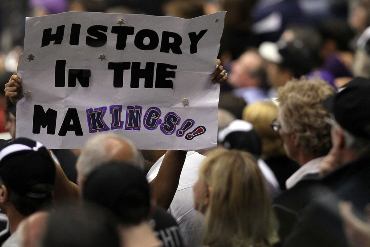 """LOS ANGELES, CA - JUNE 11:  A Los Angeles Kings fan holds up a sign """"History in the MaKings!!"""" in Game Six of the 2012 Stanley Cup Final at Staples Center on June 11, 2012 in Los Angeles, California.  (Photo by Jeff Gross/Getty Images)"""
