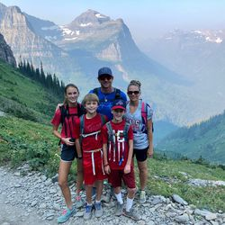 Jared and Kim White with their children on a hike in Glacier National Park, Montana.