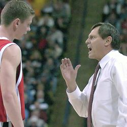 Southern Utah coach Roger Reid, right, talks to David Marke during a timeout during SUU's game against Utah State on Nov. 9, 2007, in Logan.