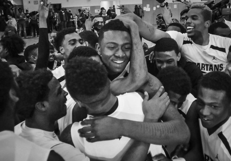 Teammates hug Tyquone Greer after winning a sectional game against Fenwick in 2004.