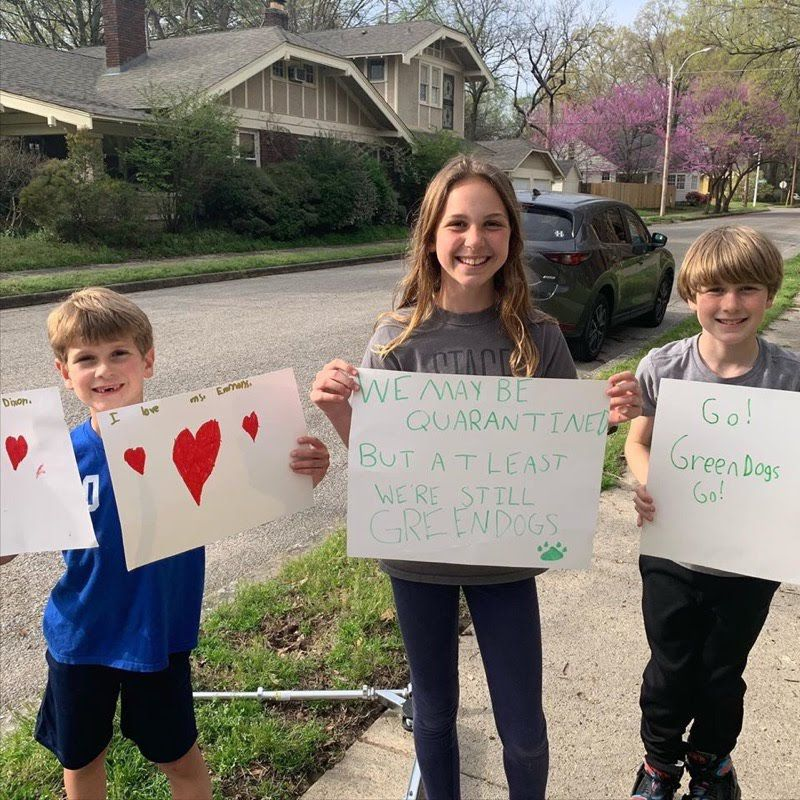 Students made signs to greet their Snowden School teachers who caravanned through neighborhoods near the school while Shelby County Schools is closed over coronavirus concerns.