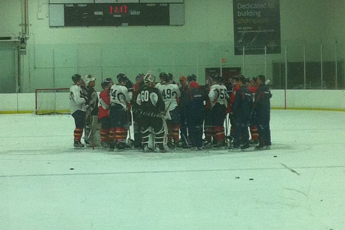 The Cats prospects gather at center ice on Day Three of Development Camp.