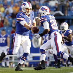 Aug 16, 2013; Orchard Park, NY, USA; Buffalo Bills quarterback Kevin Kolb (4) hands off to Buffalo Bills running back C.J. Spiller (28) during the first quarter against the Minnesota Vikings at Ralph Wilson Stadium.