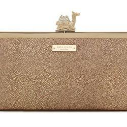 "<b>Kate Spade</b> Owwn of the Nile clutch, <a href=""http://www.katespade.com/queen-of-the-nile-camel-clutch/PXRU3625,default,pd.html?dwvar_PXRU3625_color=299&start=2&cgid=handbags-clutches"">$348</a>"