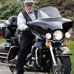 Daryl Ruff brings his customized Harley Ultra Classic, which weighs about 800 pounds and produces about 90 horsepower, to a stop in front of his home in Washington.