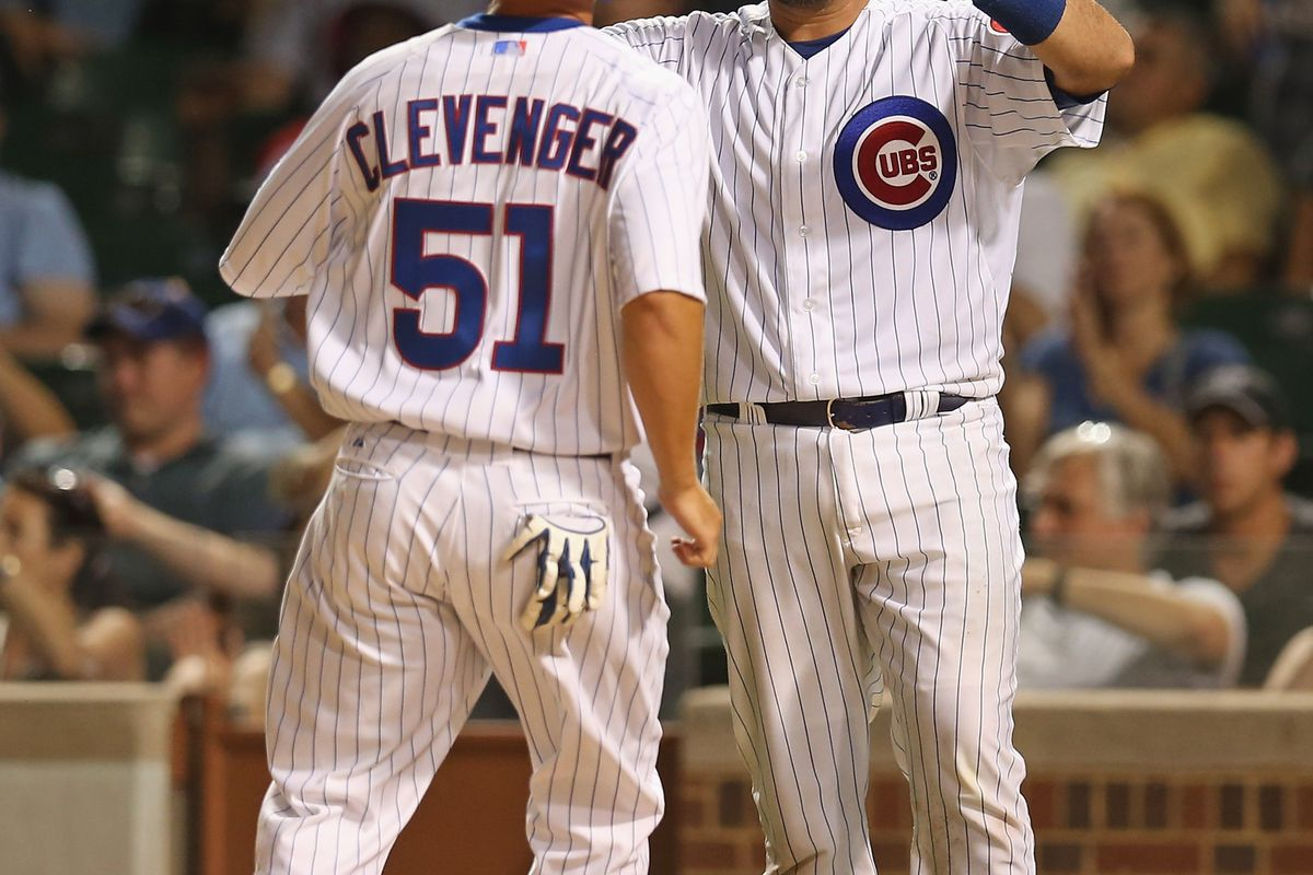 Geovany Soto of the Chicago Cubs greets teammate Steve Clevenger after both scored runs against the Miami Marlins at Wrigley Field in Chicago, Illinois. (Photo by Jonathan Daniel/Getty Images)