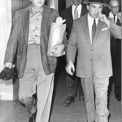 """Reporting to court on a murder indictment with his bail bondsman in 1961. Photo via the <a href=""""http://latimesblogs.latimes.com/thedailymirror/2010/03/still-on-jury-duty-3.html"""">LAT</a>."""