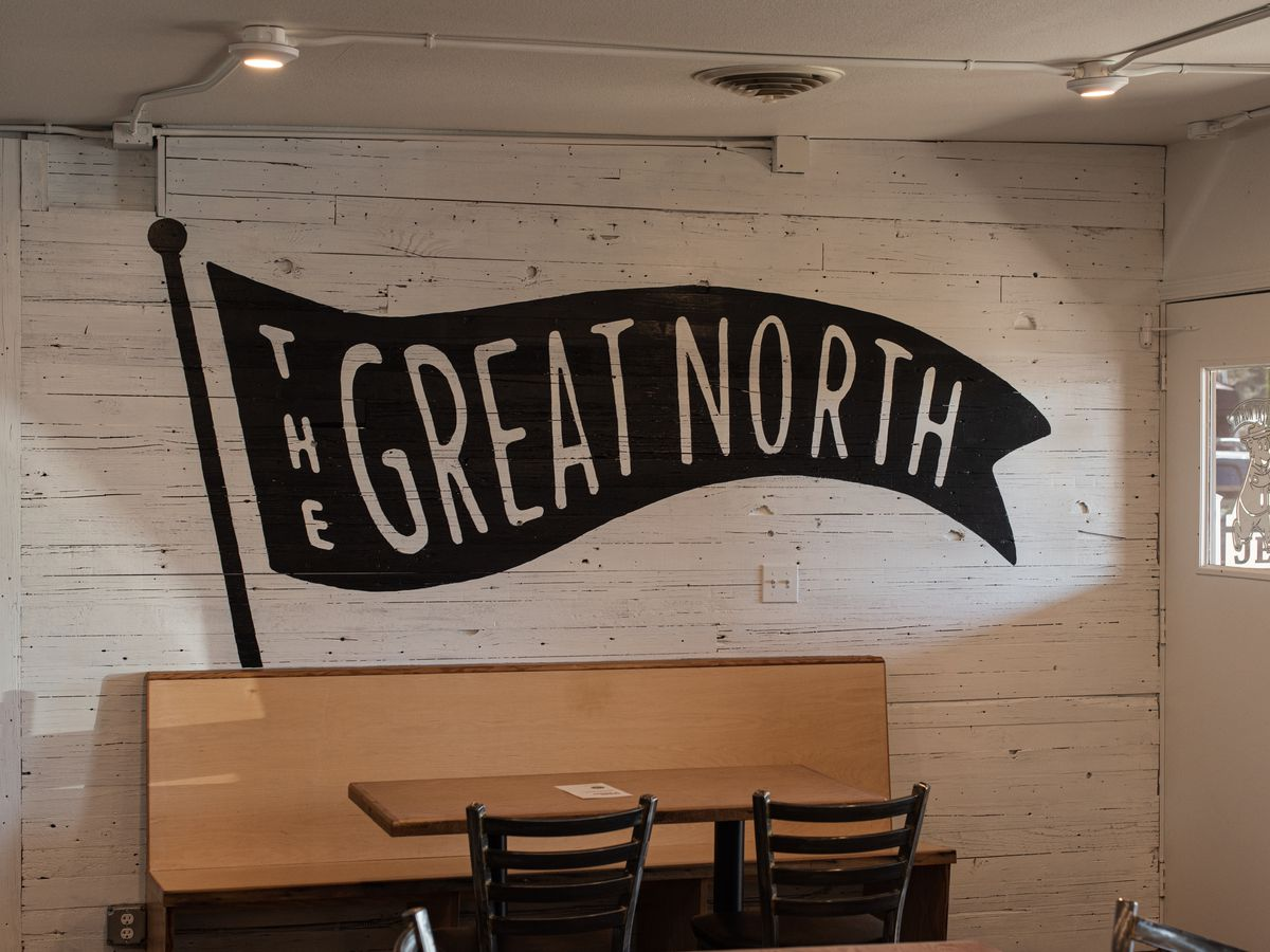 The wall at the Great North in Vancouver, Washington, shows the name of the shop displayed on a painted pennant.