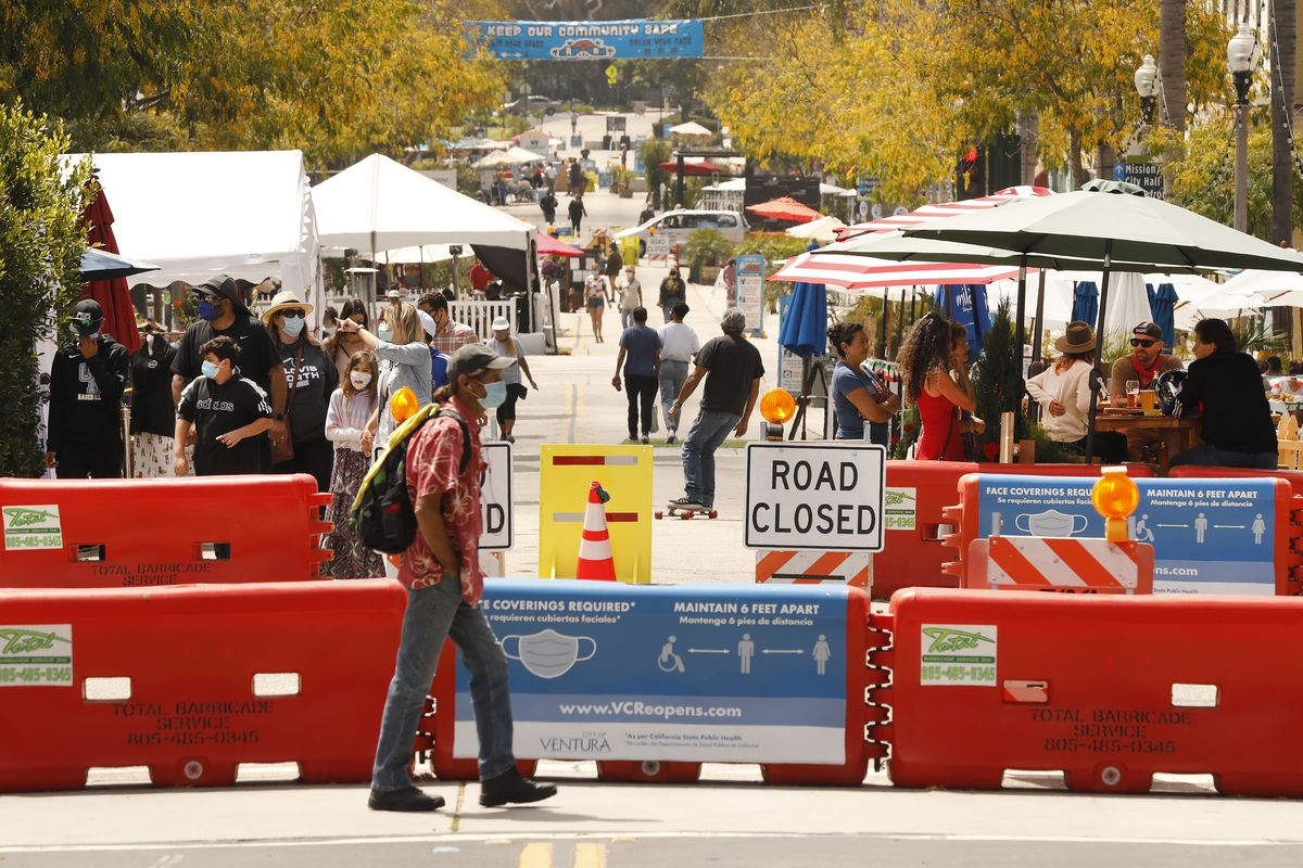 Pedestrians are required to wear a mask and practice social distancing when visiting Main Street in downtown Ventura which has been closed to vehicle traffic to allow restaurants and businesses to accommodate for outdoor activity in the era of the Covid-19
