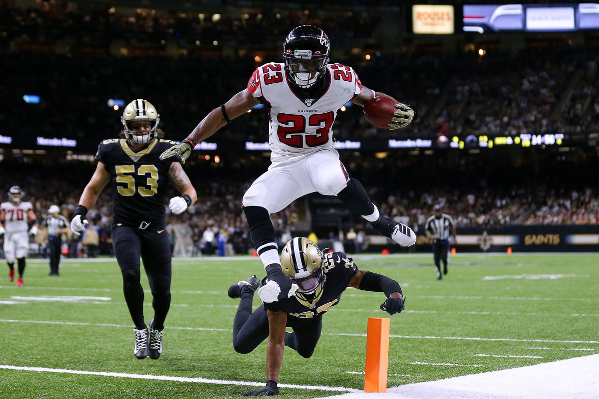 Brian Hill of the Atlanta Falcons scores a touchdown as Eli Apple of the New Orleans Saints and A.J. Klein defends during the second half of a game at the Mercedes Benz Superdome on November 10, 2019 in New Orleans, Louisiana.