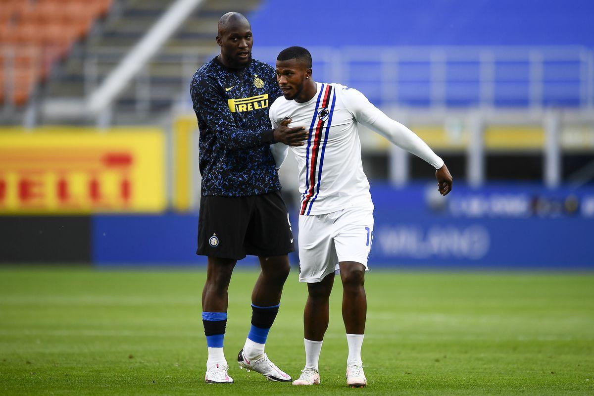 Romelu Lukaku (L) of FC Internazionale speaks with Keita...
