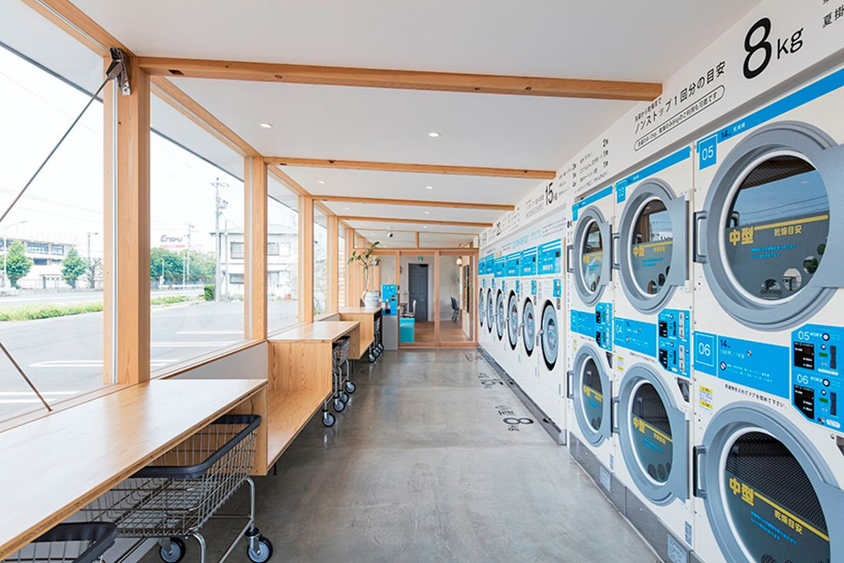 Modern laundromat cafe in japan helps customers pass the time curbed it has since closed but word on the street is that another laundromat cafe is now popping up across the river in brooklyns williamsburg solutioingenieria Choice Image