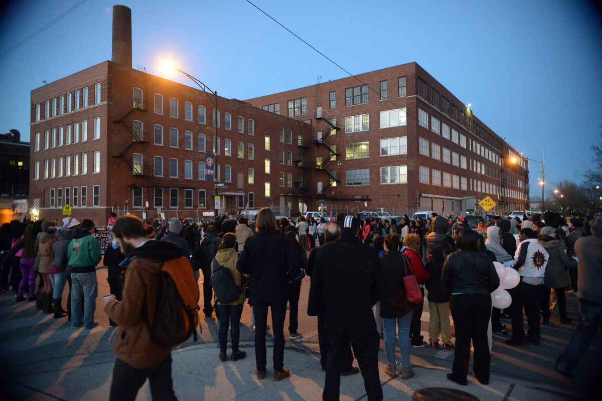 A vigil for Pierre Loury, who was shot and killed by police, was held the day after the shooting outside a Chicago Police Department facility in Homan Square. | Brian Jackson/For the Sun-Times