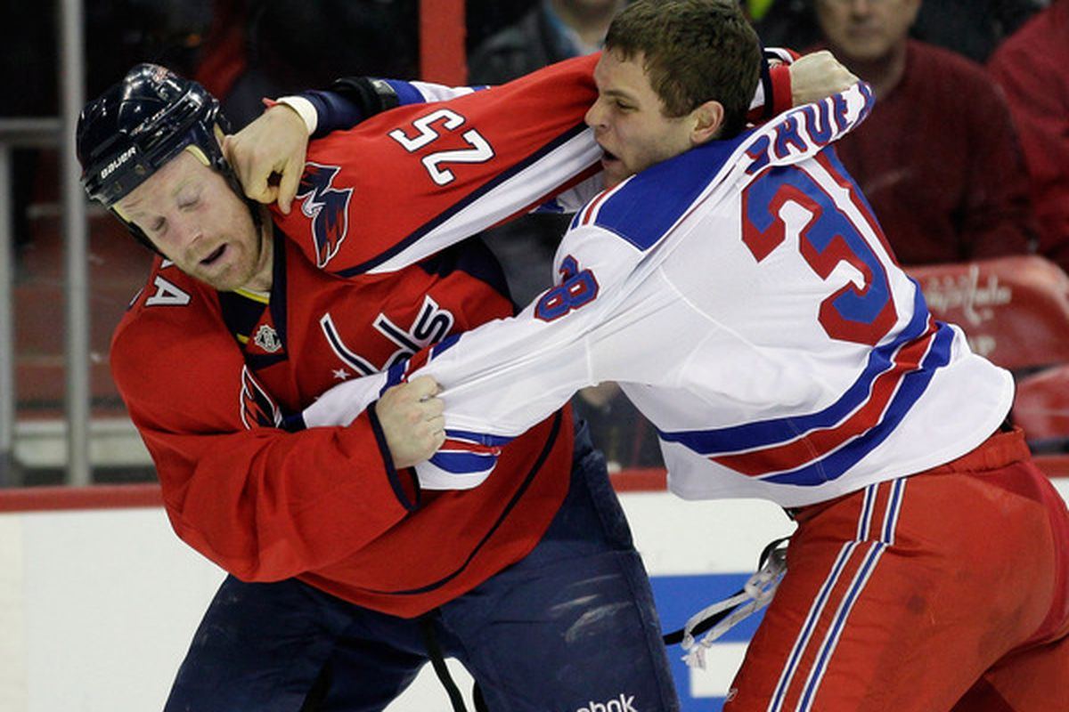 WASHINGTON DC - FEBRUARY 25:  Jason Chimera #25 of the Washington Capitals and Michael Sauer #38 of the New York Rangers fight during the first period at the Verizon Center on February 25 2011 in Washington DC.  (Photo by Rob Carr/Getty Images)