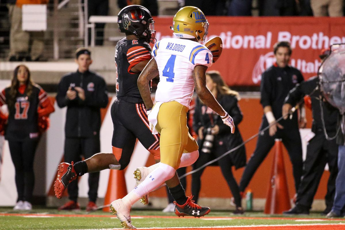 Utah Utes running back Zack Moss (2) runs for a touchdown, putting the Utes up 31-10 over the UCLA Bruins after the PAT, at Rice-Eccles Stadium in Salt Lake City on Friday, Nov. 3, 2017.