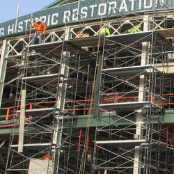 Sun 12/20: Dismantling the main gate scaffolding, closer view -