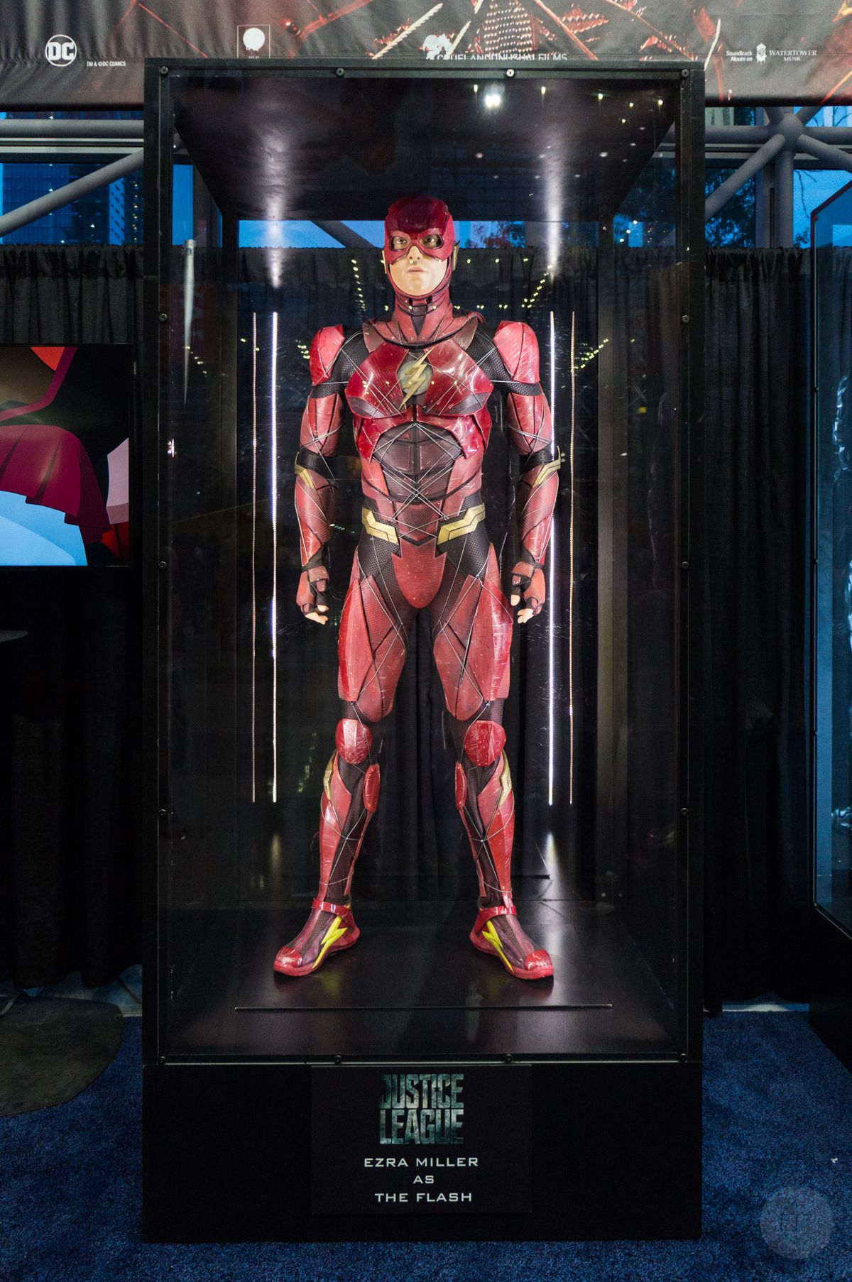 The Flash costume from Justice League movie in glass case at NYCC 2017