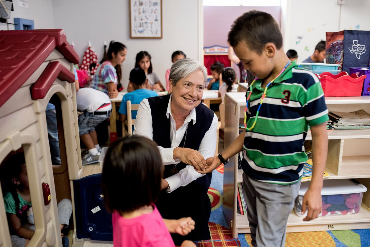 Sister Norma Pimentel hands a child some candy at the Humanitarian Crisis Respite Center in McAllen, Texas, on July 19, 2018.