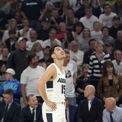 Utah State guard Abel Porter watches a replay on the screen at the Spectrum near the end of the Aggies' win over No. 12 Nevada on March 12, 2019.