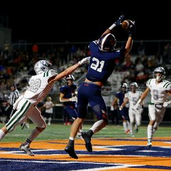 Brighton's Lander Barton makes a catch for a touchdown over Olympus' Ty Seagle as they play a high school football game at Brighton in Cottonwood Heights on Friday, Sept. 10, 2021. Olympus won 35-28.