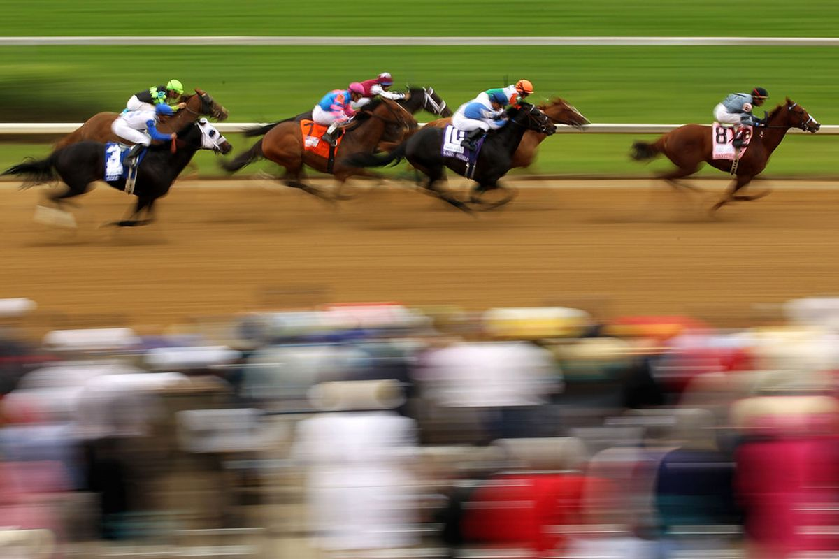 LOUISVILLE, KY - MAY 07:  Horses run down the front stretch as they race during the third race on the day of the 137th Kentucky Derby at Churchill Downs on May 7, 2011 in Louisville, Kentucky.  (Photo by Al Bello/Getty Images)