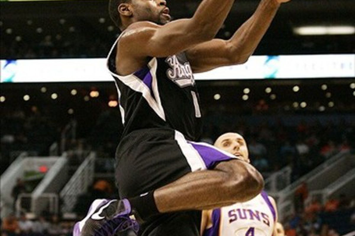 Mar 4, 2012; Phoenix, AZ, USA; Sacramento Kings guard Marcus Thornton (23) goes in for a lay-up during the first quarter as Phoenix Suns center Marcin Gortat (4) trails at US Airways Center.  Mandatory Credit: Jake Roth-US PRESSWIRE