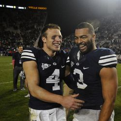 Brigham Young quarterback Taysom Hill (4) and linebacker Kyle Van Noy (3) celebrate the Cougars' win over Boise State at LaVell Edwards Stadium on Friday, Oct. 25, 2013.