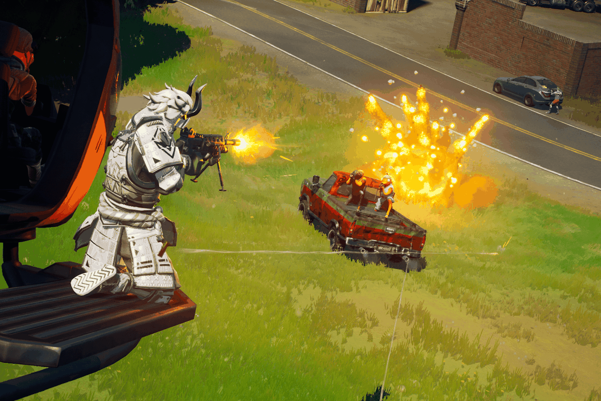 an explosion behind a pickup truck in Fortnite
